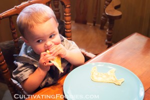 Little chef eating pancakes