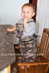 Little Chef grinning and cooking