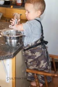 Little Chef stirring pancake batter