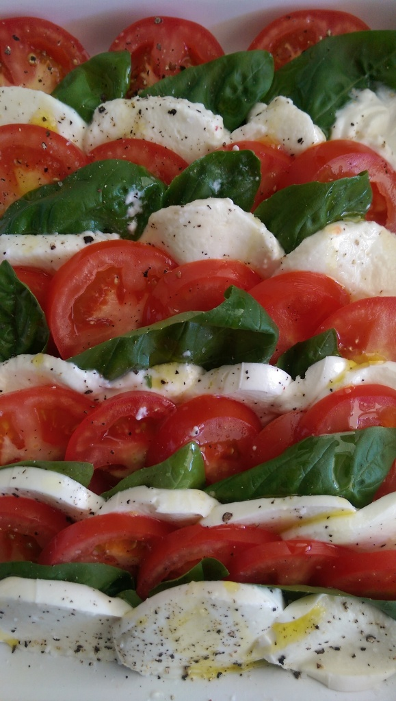 Tomatoes, basil, and buffalo mozzarella drizzled with olive oil and salt and Pepper.  Simple, yet perfect.